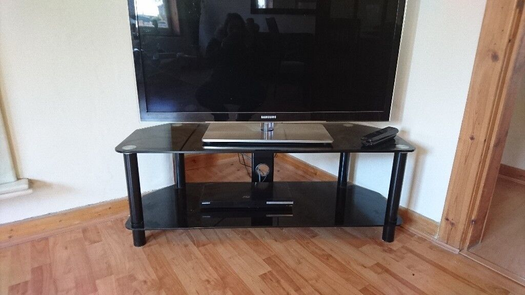 Set of two TV stands / side or coffee tables black glass