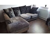 3 seater corner sofa, gray with 7 cushions.