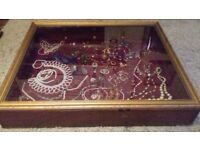 large glass top wooden display case