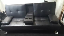 Black faux leather sofa bed good condition