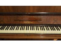Nathaniel Berry Walnut upright piano in nice playing order.