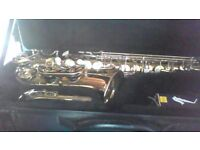 volt alto saxaphone with case, neckstrap , spare reeds and book. As new condition.