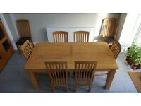 Solid oak extending dining table - with or without chairs (x8)