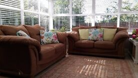 Lovely 2x2 seater fabric sofas for sale.