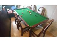 Pool Table/ dining table 6 chairs.