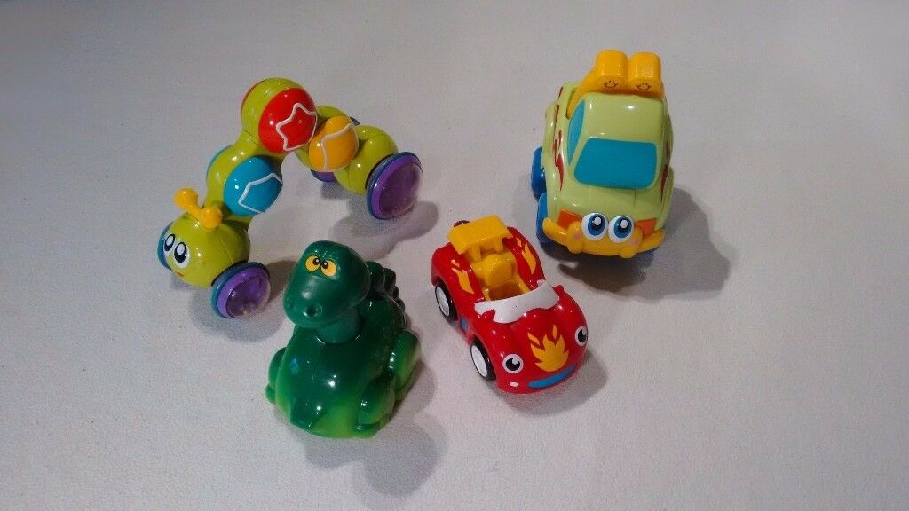 Self Propelling Toys- caterpillar, truck, car, and a dinosaur.