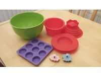 Cake moulds, mixing bowl and pastry cutters