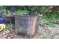 2 Big Iron planter/ pots. Very old. Strong and heavy