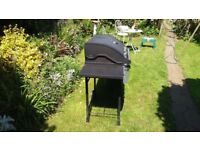 Argos 4 burner bbq with side burner good working condition inc empty patio gas bottle.