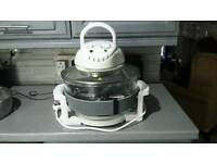 Larger halogen oven hardly used excellent condition.