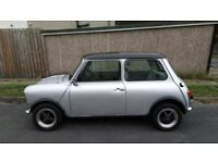 Classic MINI in silver 998cc with black roof with new M.O.T until September 2019