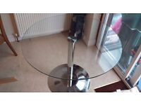 John lewis Polar glass and chrome dining table, seats 4 comfortably.