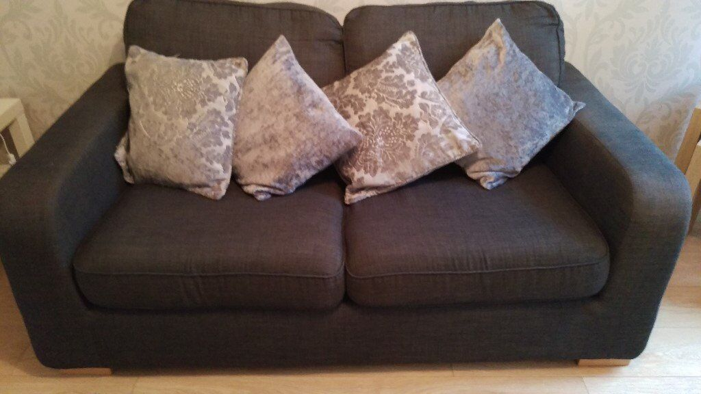 Grey 2 Seater sofa be with foot stool and matching cushions