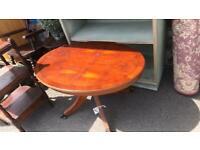 Sturdy oval pedestal coffee table