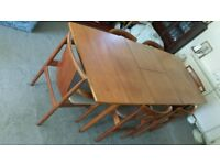 Extending teak table and 6 dining chairs