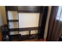 Black Ikea TV stand with shelves