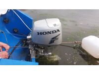 Honda 30hp outboard engine, electric tilt and start controls and dials