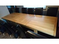 Solid oak extending dining table 1.8-2.7m with 10 Faux Leather chairs