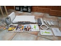 WII CONSOLE WITH CONTROLLER , NUNCHUCK AND GAMES