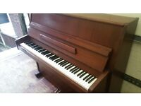 Upright piano made by reputable piano maker Challen