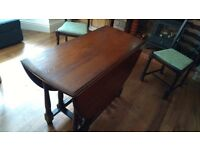 Oval shaped table with 4 chairs. Everything is solid wood, in very good condition.