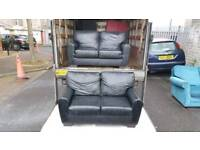 2+2 black leather sofas