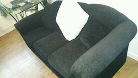 Contemporary black fabric 3 seater sofa in immaculate condition
