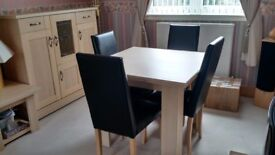 Beautiful Caxton light wood veneer extendable table and four faux leatherchairs