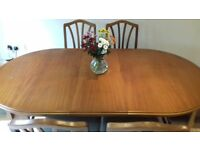 Extendable solid teak dining table and 6 chairs (2 carvers). Good condition and looking a new home..