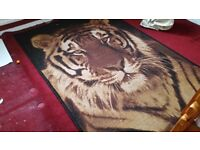 Beautiful Tiger Rug. Almost new. Only 20pounds. Collection only