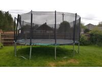 For Sale 16ft Trampoline with safety net and ladder.