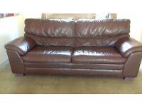 Large comfortable brown leather sofa