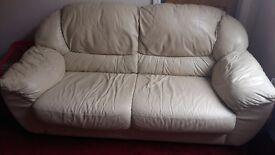 3 X 2 cream leather sofas in good condition
