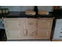 Cream Aga four oven cooker - Oil fired.
