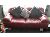 2 x 2 seater red leather couches and footstool