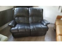 black leather reclining two seater sofa