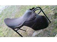 "Brown leather 17"" saddle"