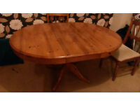 Solid pine pedestal table round with extension to oval with chairs
