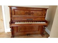 Antique upright piano (1898). Burr walnut and burr walnut veneer.