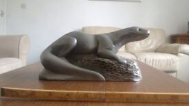Pewter Otter 40 years old, 10 inches long, and 5 inches tall