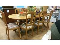 Solid pine table with 8 chairs.. one chair has been repaired.