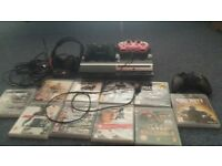playstation 3 console plus turtle beach mike, 3 controllers and 10 popular games.