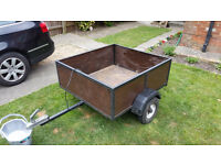 Trailer with metal framed wooden box