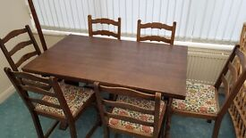 Dark wood extending table, with 4 chairs.