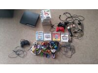 PS3 slim budle with 17 games and 4 game skylander bundle including 24 pieces