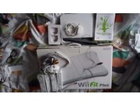 Nintendo Wii - wii fit board - four official controllers and nunchuk