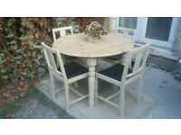 Lovely solid pine, round, french country, farmhouse table and 4 oak chairs