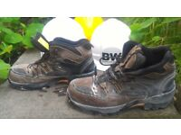 protective shoes in good condition 11nm and 3 protective helmets. two white and one yellow