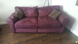 2 purple/burgundy couches