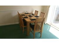 Light Oak coloured family Dining table and 5 chairs